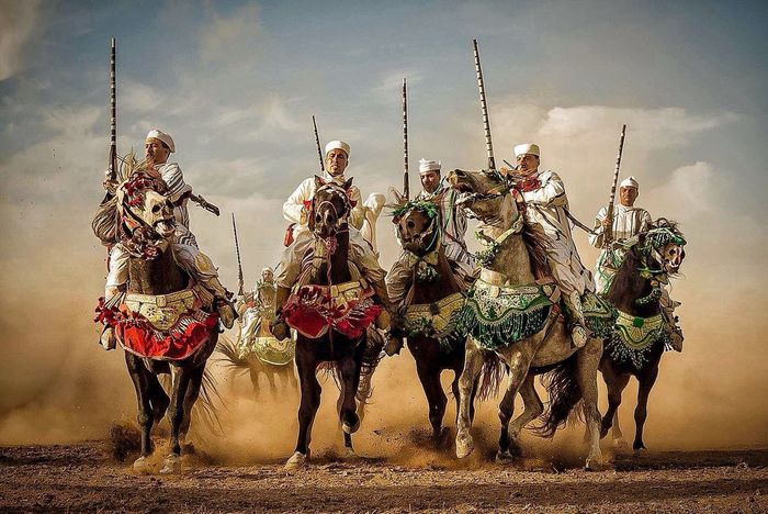 Horses Men On Horses Fantasy Power Rifle Range Men Perspective Point Of View The Story Behind The Picture Playground EventPhotography Morocco Tradition Entertainment Beauty Stronger Culture EyeEm Best Shots Racing Horse Winners ! Pointandshoot Traditional Costume