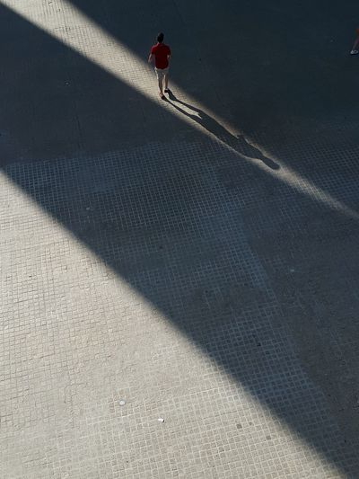 High angle view of person walking on street