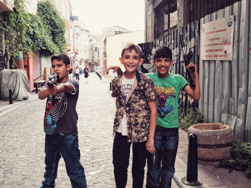People And Places Children are Playing Police and Thife or Gangster on the Street in Balat Istanbul Turkey Togetherness Bonding Friendship Looking At Camera Smiling Happiness Standing Friends Childhood Lifestyles Life Elementary Age Boys Fun Enjoy The New Normal