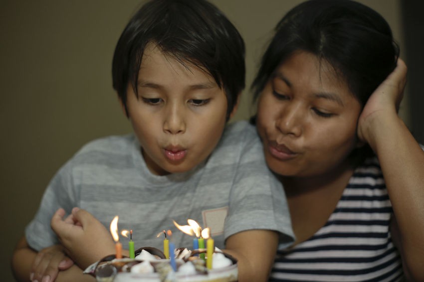 Mother and son celebrating birthday blowing candles on a cake Celebration Happiness Happy Happy People Mother And Son Birthday Birthday Cake Birthday Candles Blowing Candles Bonding Candle Celebrating Child Childhood Close-up Enjoyment Family Headshot Indoors  Kid Love Real People Togetherness Two People