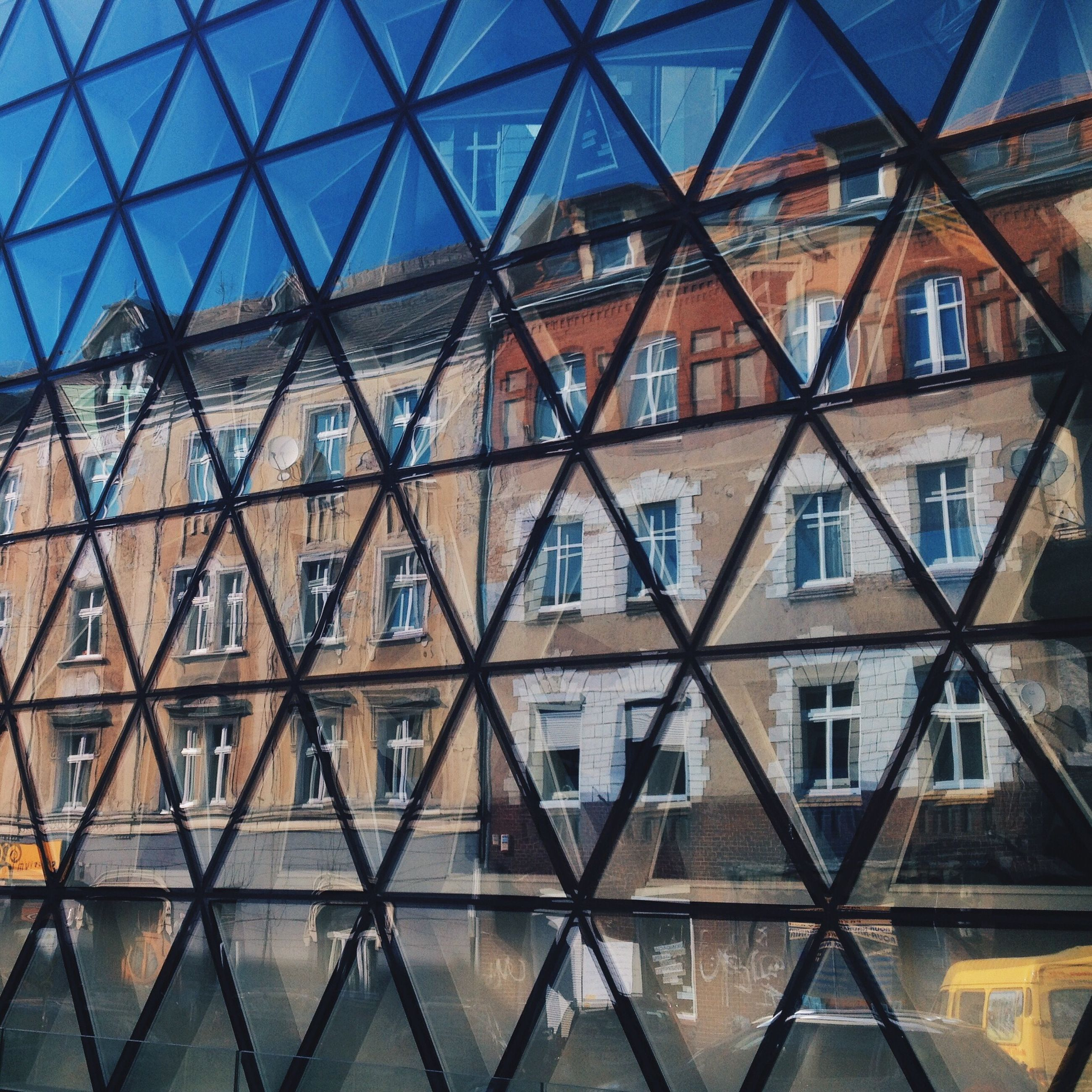 architecture, built structure, window, building exterior, full frame, glass - material, low angle view, pattern, backgrounds, indoors, reflection, building, geometric shape, architectural feature, design, day, repetition, glass, no people, transparent