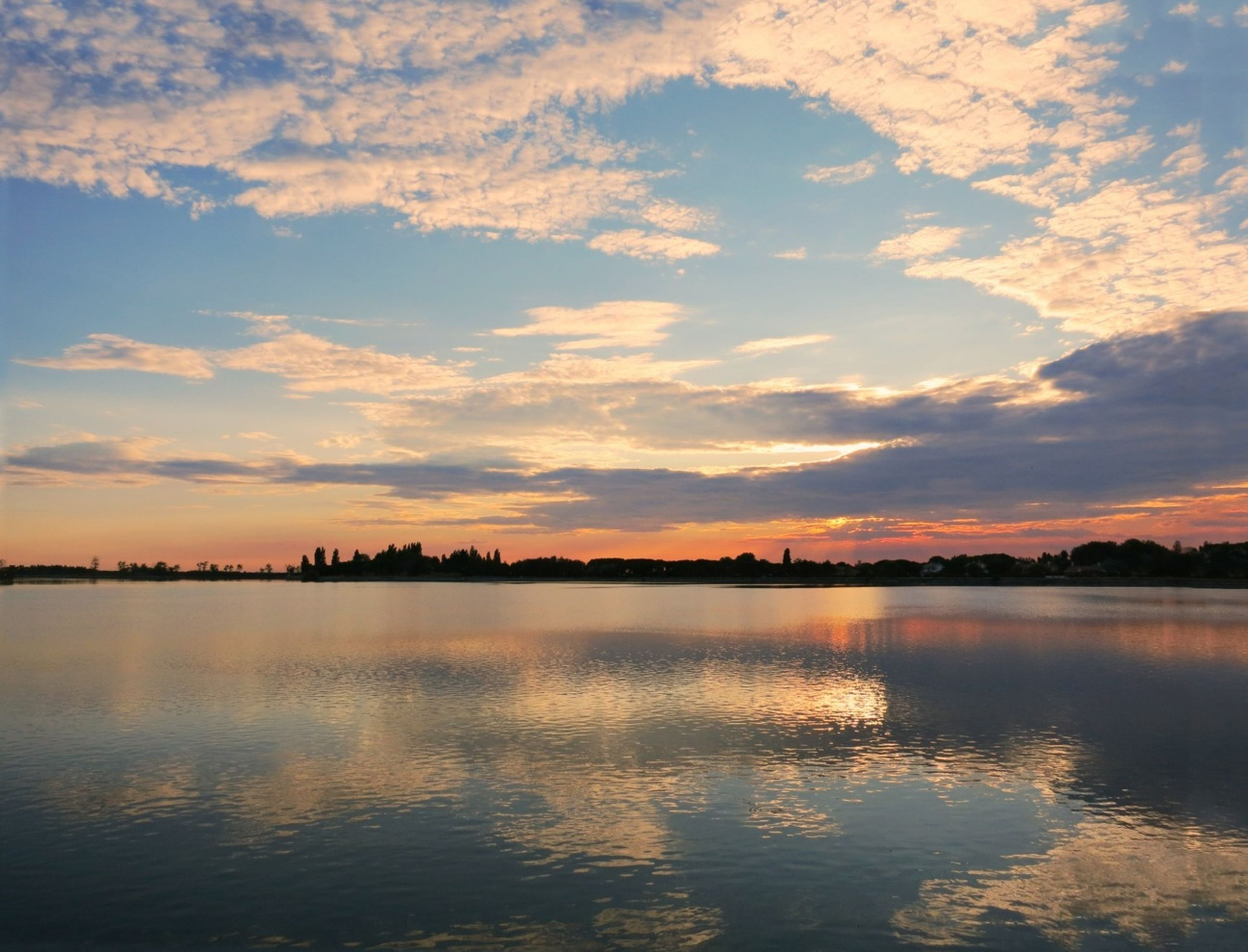 water, sunset, sky, waterfront, tranquil scene, scenics, tranquility, cloud - sky, reflection, beauty in nature, cloud, lake, idyllic, nature, silhouette, cloudy, sea, orange color, rippled, outdoors