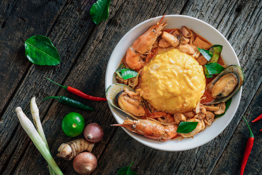 "Rice and scrambled eggs topped with ""Tom Yum Seafood"" sauce Asian Food Bowl Chili  Cuisine Eggs Food Lemon Red Seafoods Shrimp Thai Food Market Reviewers' Top Picks"