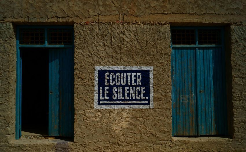 Listen to silence Architecture Blue Building Exterior Built Structure Ciment Closed Difference  Doors Double French Graffiti Listen Listen To Silence Message Message To The World No People Open Parallel Rectangle Shadow Silence Twins Two Wall
