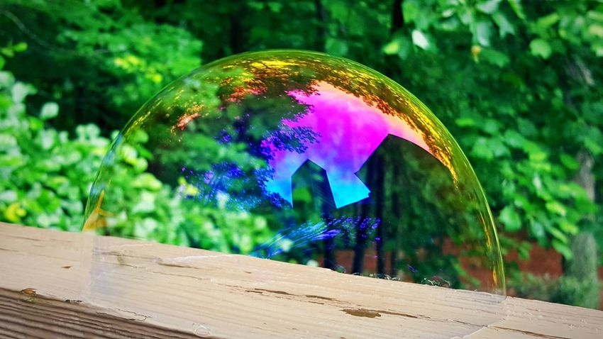 Bubble globe with house silhouette Wood - Material Outdoors Multi Colored Motion Tree No People Day Nature Close-up Bubbles Spherephotography Beauty In Nature Sky Nature Fragility Plant Sphere Sphere Glass Sunset Scenics Scenery Shots Rethink Things Visual Creativity