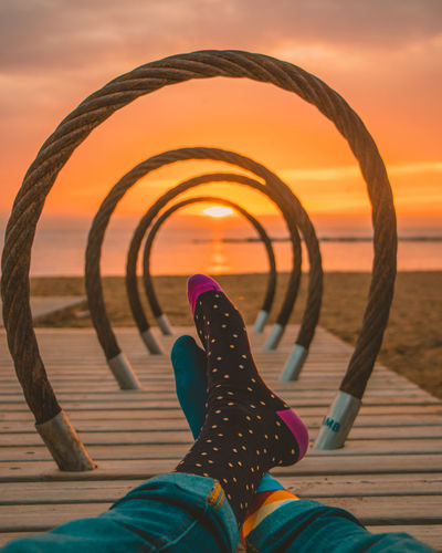 Happy colorful socks on the beach of Barcelona during the sunrise Barcelona Beach Beachphotography Happy Socks Horizon Over Water Human Body Part Human Foot Human Leg Land Leisure Activity Lifestyles Low Section Nature One Person Orange Color Outdoors Personal Perspective Real People Relaxation Sea Shoe Sky Socks Sunset Water