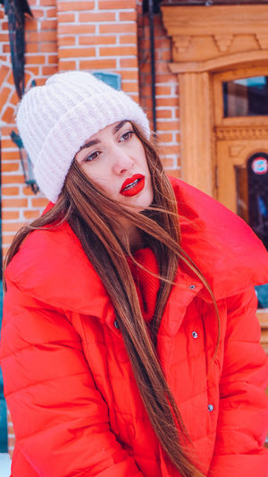 Beautiful happy smiling woman on the street in warm red winter coat on Christmas time on snowing. Winter Cold Temperature Warm Clothing Snowing Smiling Christmas Wintertime Woman Power women around the world EyeEm Best Shots EyeEm Colorful! Fashion Stories Red Lipstick Clothing Young Women Young Adult One Person Hat Women Red Long Hair Portrait Hair Looking At Camera Architecture Adult Lifestyles Waist Up Coat Beautiful Woman Hairstyle Outdoors Scarf Winter Coat
