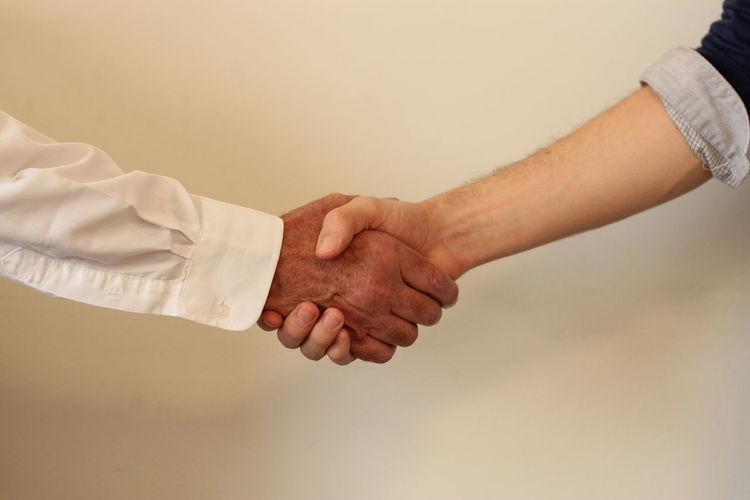 Cropped image of men shaking hands