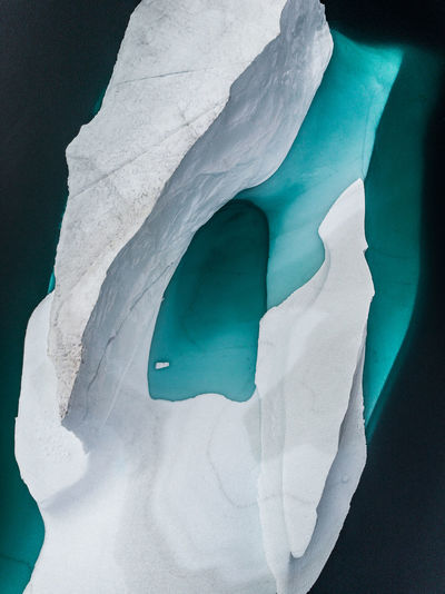 Aerial view of iceberg melting in sea