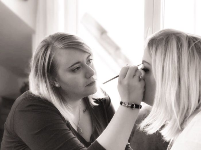 Close-Up Of Artist Applying Make-Up On Woman Face