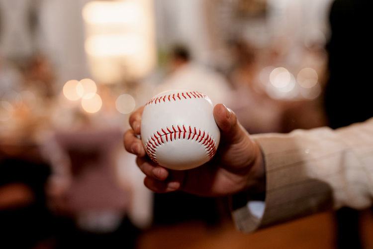 Close-up of hand holding baseball