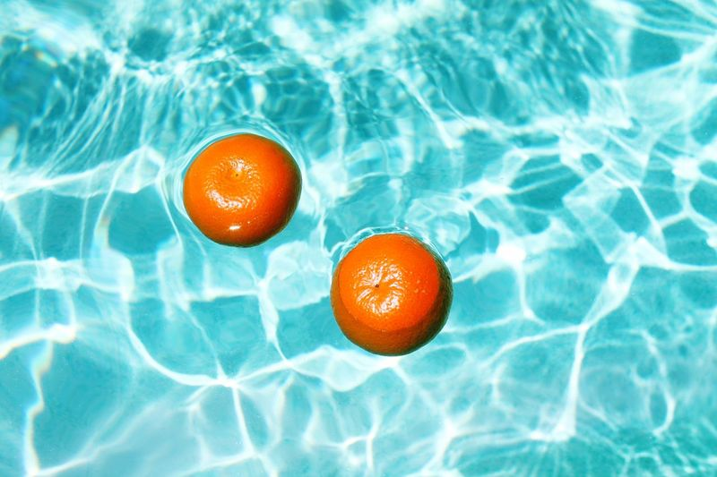 High Angle View Of Oranges In Swimming Pool