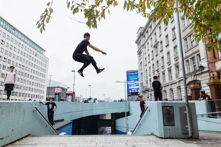 Full length of man skateboarding in city