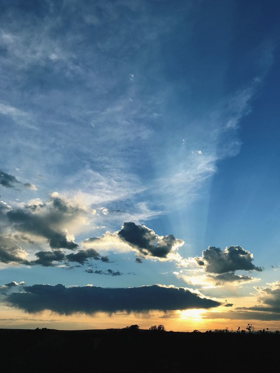 sky, beauty in nature, scenics, nature, tranquil scene, cloud - sky, sunbeam, silhouette, tranquility, no people, outdoors, idyllic, sunlight, blue, sunset, day, tree
