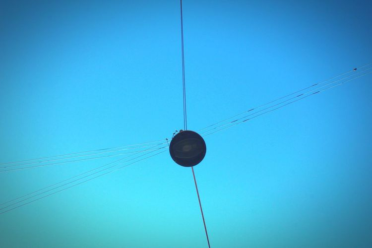 Blue Hanging Electricity  Low Angle View Day Clear Sky Sky No People Technology Innovation Outdoors Close-up The Graphic City