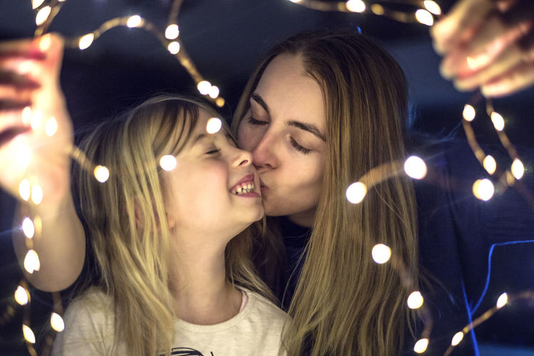 Young Adult Young Women Illuminated Night Real People Headshot Lifestyles Leisure Activity Portrait Adult Lighting Equipment Decoration Emotion One Person Indoors  Women Long Hair Hair Hairstyle Positive Emotion Beautiful Woman Teenager Couple - Relationship