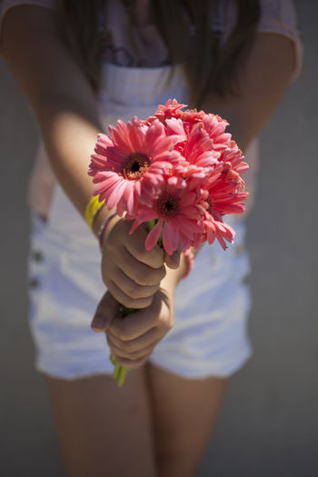 Close-Up Of Woman Holding Flowers