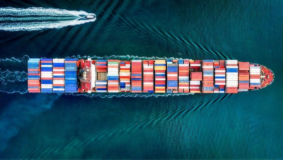 High angle view of container ship in sea