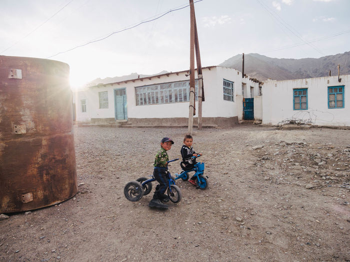 Two young children ride bikes around the streets of Murghab. One young boy is wearing his fathers oversized boots and was struggling to move the bike. Astronomy Boys Child Childhood Day Full Length Leisure Activity Males  Men Murg Murghob Nature Outdoors Portrait Poverty Real People Sky Tajiistan Week On Eyeem The Photojournalist - 2018 EyeEm Awards The Great Outdoors - 2018 EyeEm Awards The Traveler - 2018 EyeEm Awards The Portraitist - 2018 EyeEm Awards The Street Photographer - 2018 EyeEm Awards #urbanana: The Urban Playground A New Perspective On Life Capture Tomorrow