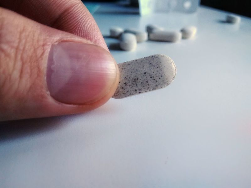 Pill Human Finger Human Hand Close-up One Person Adult Only Men Choice Drug Pharmacy Medcine Medication Doctor  Desk Pharmacology Alternative Homeopathy Addiction Healing Health Vitamins White