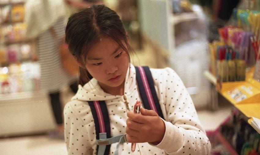 Girl holding pen in hand