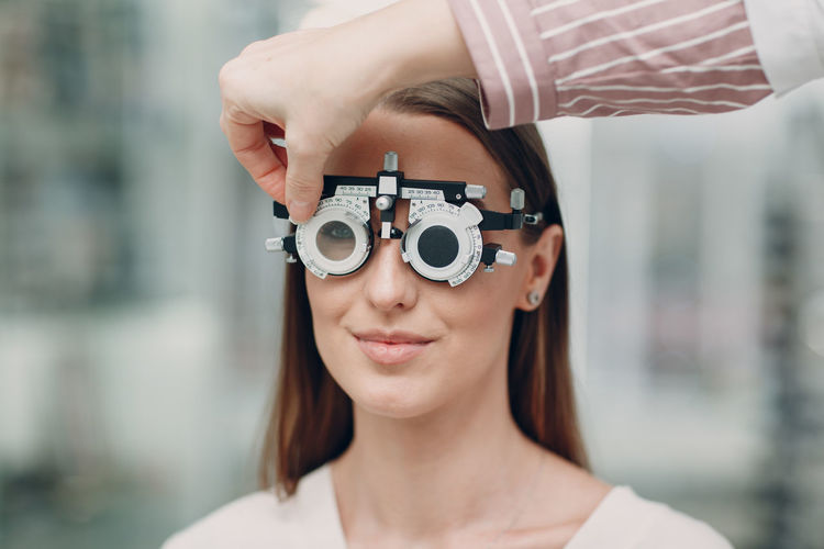Portrait of woman wearing eye test equipment