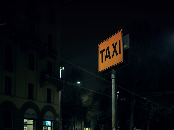 taxi Autostop City Dark Background Late Night Night Lights No People Orage Outdoors Pole Rental Rental Car Returning Home Ride Road Sign Road Signs Sign Street Night Taxi Taxi Sign Taxy Text Tornare Tram Wire Whistle