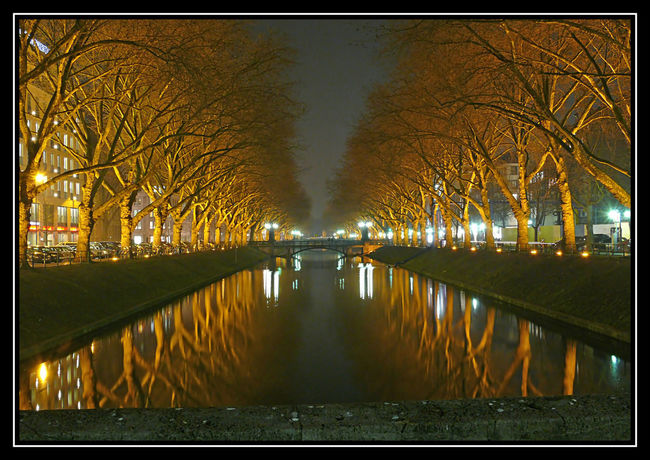 Architecture Auto Post Production Filter Bare Tree Built Structure Connection Diminishing Perspective Illuminated Nature Night No People Outdoors Plant Reflection River Sky Transfer Print Tree Treelined Water Waterfront