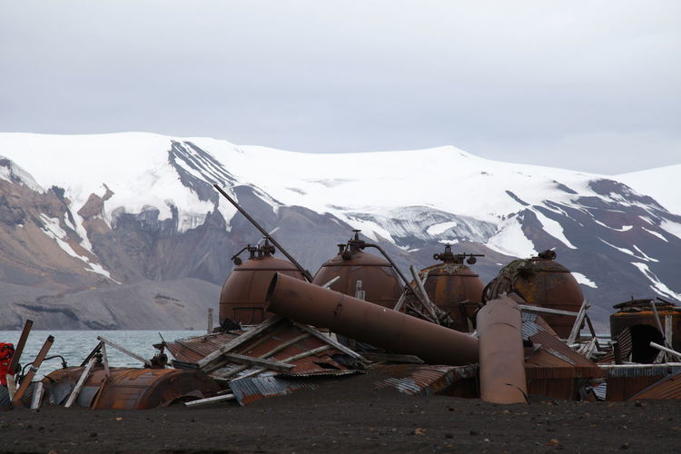 Rusty objects against snow covered landscape