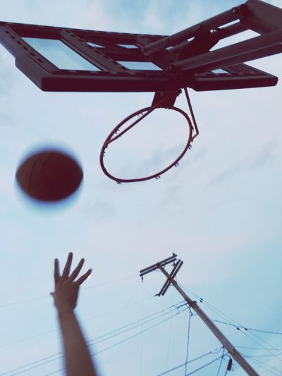 Playing Basketball In The Street Sports Hoop New Jersey Kids Playing One Person Real People Human Body Part Human Hand Sunset Summer Nights Basketball Hoop Sky Close-up Basketball - Sport People