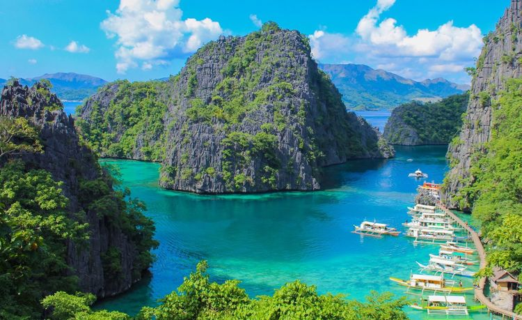 The iconic view of coron Island Philippines Coron, Palawan Water Tree Plant Nature Beauty In Nature Scenics - Nature Sky Sea Tranquility Cloud - Sky Tranquil Scene Turquoise Colored EyeEmNewHere