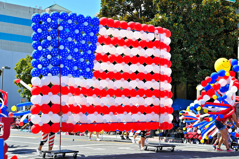 The Celebration of Independence Day in Modesto California of 4th Of July Day Multi Colored Group Of People Nature Real People Celebration Incidental People Large Group Of People Balloon Outdoors Street Men Crowd Decoration Leisure Activity Tree City Plant Lifestyles