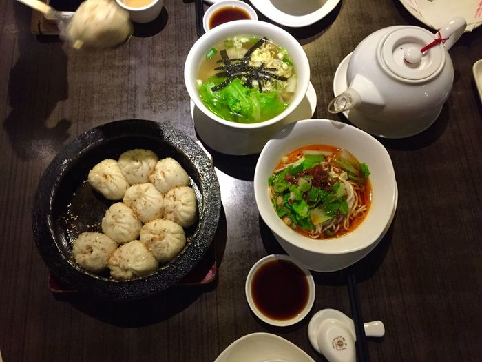 High angle view of chinese dumplings and soup on table