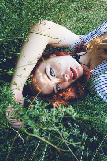 Portrait Looking At Camera Real People Grass Plant Lying Down Young Adult Headshot Leisure Activity One Person Lifestyles Nature Land Front View Young Women Day Adult Field Outdoors