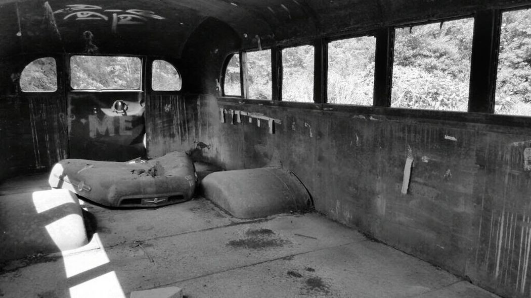 Doorway Taking Photos Abused Abandoned Inside Bus Left Behind Forgotten Abandoned & Derelict Old Old School Bus Old Bus Black & White Black And White Blackandwhite Derelict & Abandoned Derelict Neglected School Bus Door Graffiti