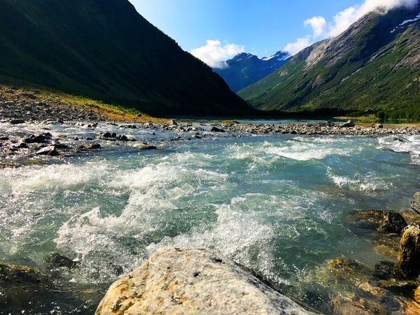 The glacier river flows to The Valley. At Jordalsbreen national park. Mountain Water Landscape