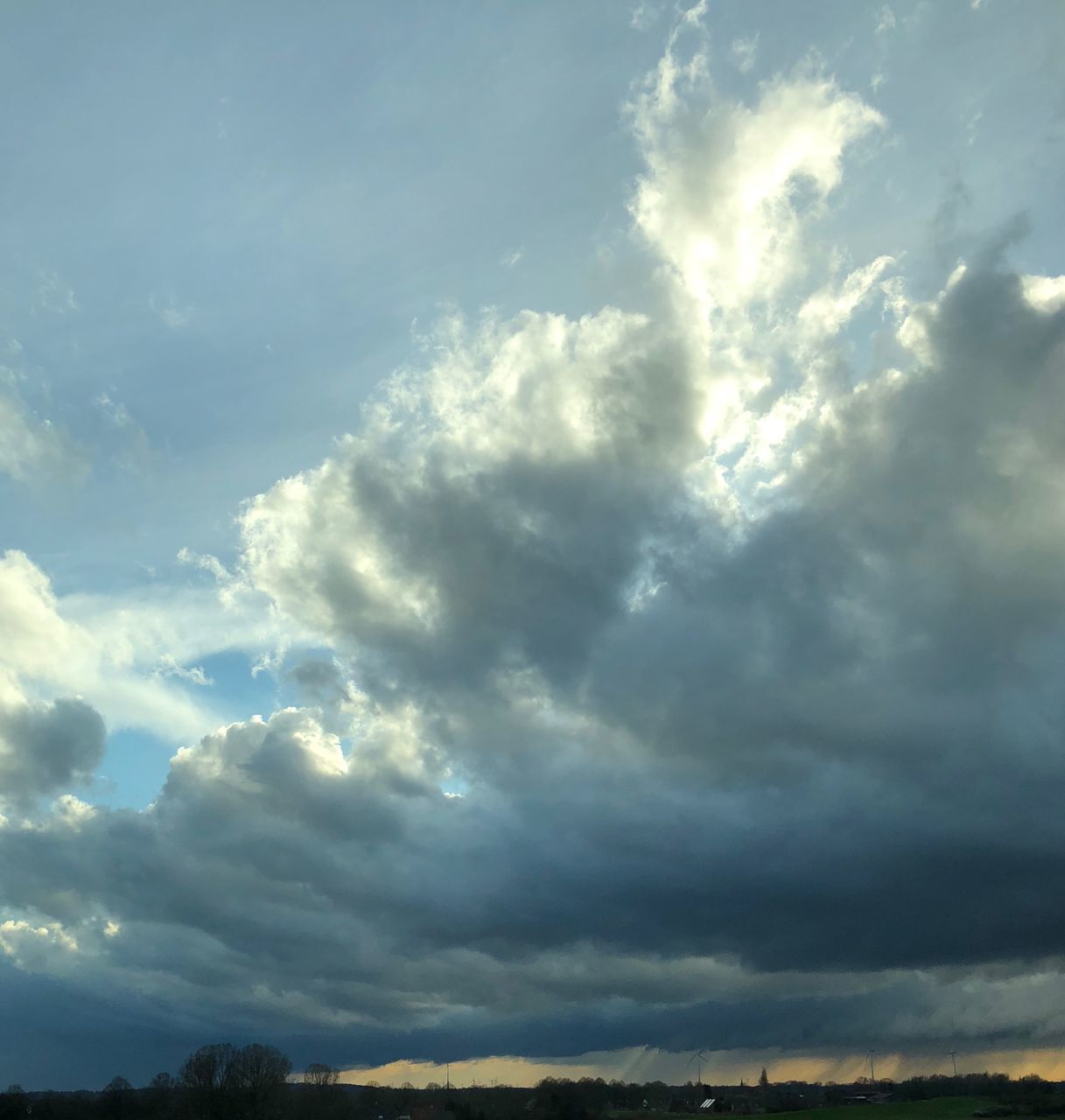 cloud - sky, sky, beauty in nature, scenics - nature, low angle view, tranquility, no people, nature, tranquil scene, day, outdoors, overcast, sunlight, storm, dramatic sky, idyllic, cloudscape, storm cloud, atmospheric mood, ominous, meteorology, streaming