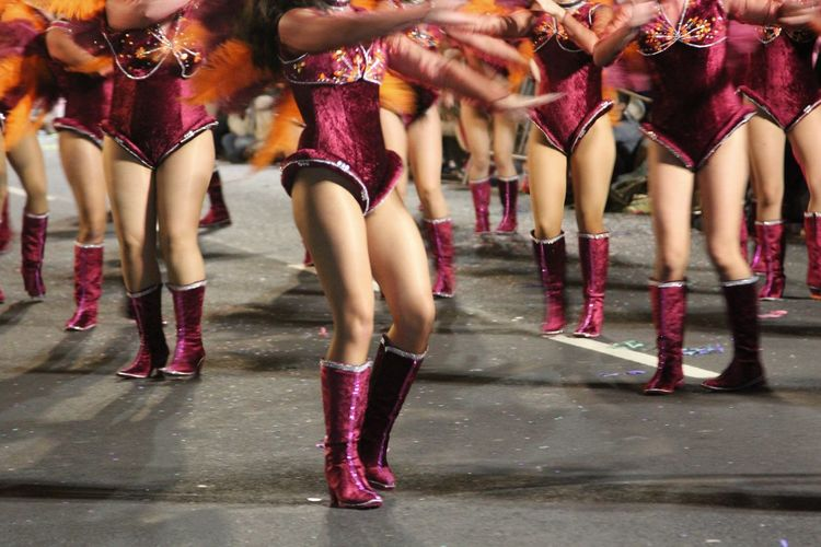 Low Section Of Female Performers On Street During Carnival In Madeira