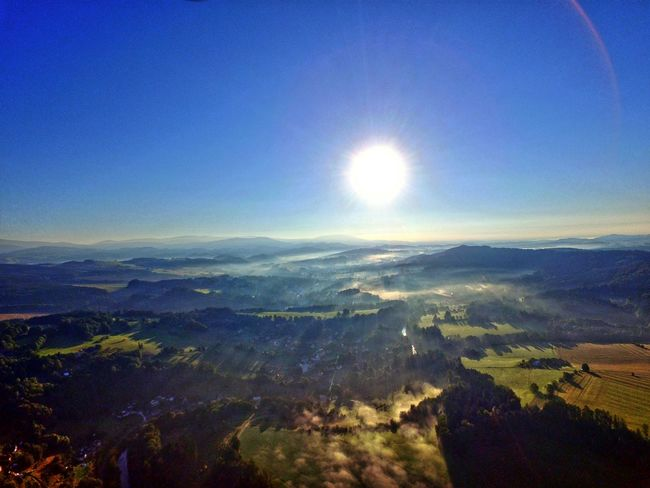 Aerial View Beauty In Nature Blue Bright Day Dramatic Landscape Landscape Lens Flare Majestic Mountain Mountain Range Nature Non-urban Scene Physical Geography Scenics Sky Sun Sunbeam Sunlight Sunny Tourism Tranquil Scene Tranquility Travel Destinations Wide Shot