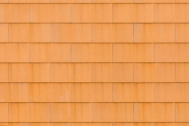 Close-up of rusty building exterior of a modern building Architecture In A Row Modern Textured  Weathered Abstract Backgrounds Brown Building Exterior Built Structure Checked Pattern Close-up Full Frame Geometric Shape Metal No People Orange Color Outdoors Pattern Rectangle Repetition Rusty Simplicity Textured  Wall - Building Feature