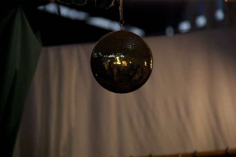 Low angle view of disco ball hanging