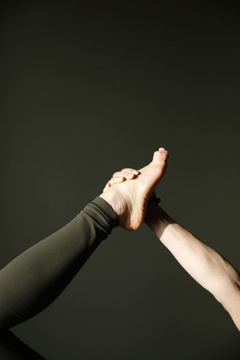 Low angle view of human hand against black background