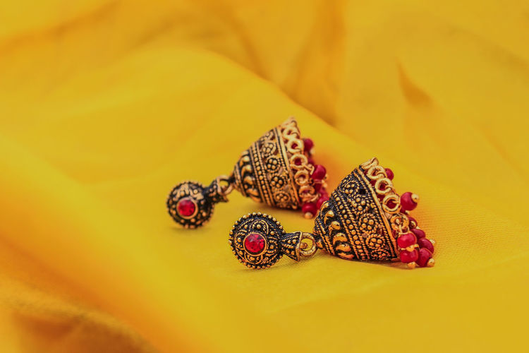Close-up of earrings on fabric