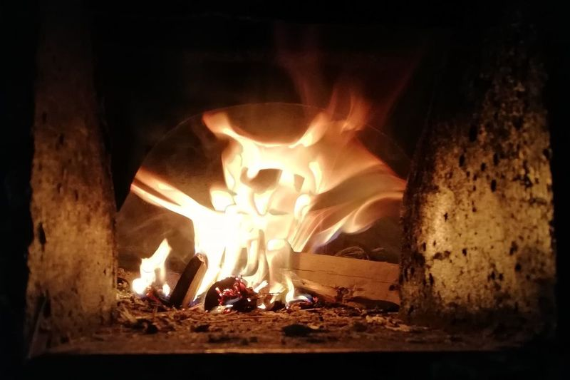 Mobility In Mega Cities Flame Heat - Temperature Burning Fireplace Campfire Night Wood - Material Bonfire Indoors  Nature No People Close-up