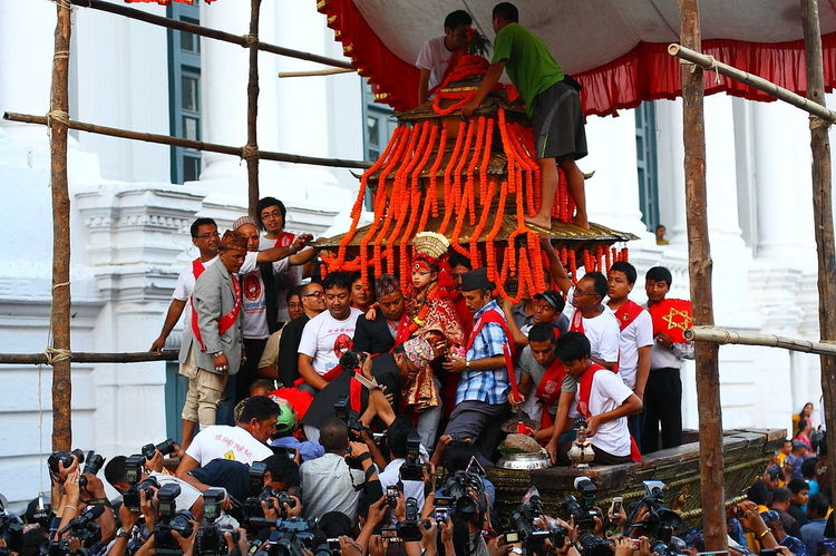 The living goddess Kumari during Indra Jatra Art And Craft Arts Culture And Entertainment Cultures IndraJatra Lifestyles Living Godess Kumari Of Nepal People Watching Standing Togetherness Carnival Crowds and Details Human Connection