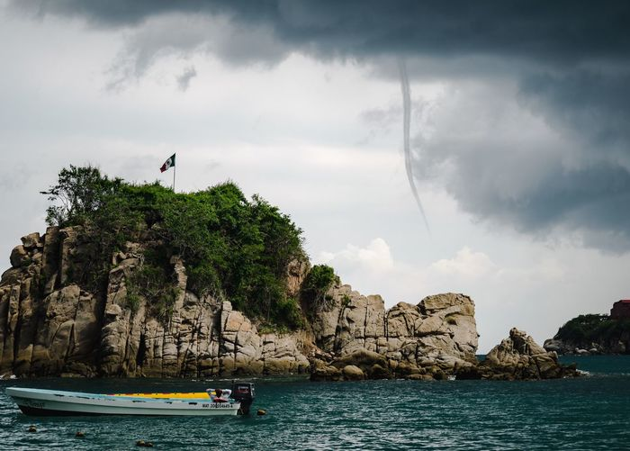 Waterspout Tornado Stormy Weather Storm Cloud Storm Huatulco Huatulco, Oaxaca, México Mexico Pacific Ocean Waterspout Water Sky Cloud - Sky Beauty In Nature Sea Rock Nature Waterfront Nautical Vessel Rock Formation Scenics - Nature Outdoors Rock - Object