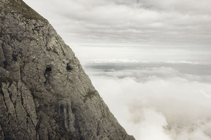 cliff of pilatus mountain in lucerne, switzerland in the morning fog Beauty In Nature Cave Cliff Clouds Copy Space Fog Foggy High Landscape Mist Morning Mountain Nature No People Outdoors Pilatus Rock Formation Scenics Sky Switzerland Tranquility