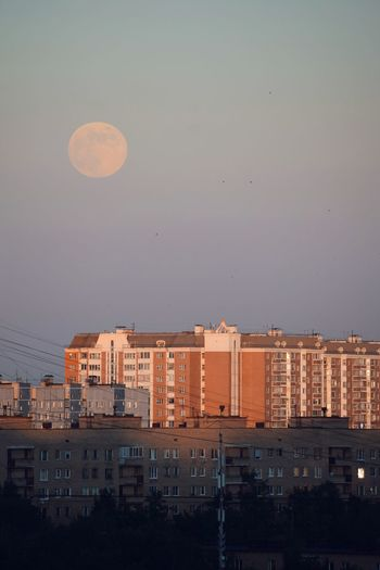 Fool Moon at Sunset 🌇🌕 Sunset Evening Sky Fullmoon Building Exterior Architecture Built Structure City Sky Building No People Moon Nature Residential District Cityscape Outdoors Full Moon Water Dusk Apartment Copy Space Location