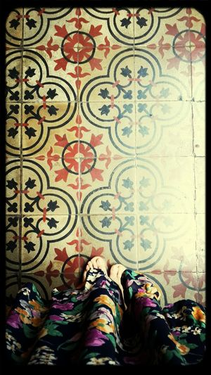 From Where I Stand: old floral pattern on tiles vs new floral pattern on dress. Old European tiles at a Peranakan house which was a result of mixed culture of Indonesia-Melayu, Chinese and European.