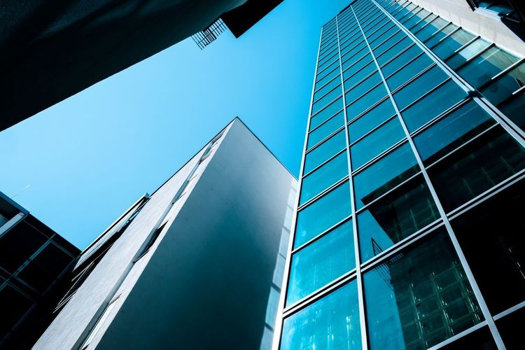 Urban Perspectives Street Photography The Devil's In The Detail Architectural Feature Architecture Building Exterior Built Structure Building Low Angle View City Office Building Exterior Modern Sky Office No People Glass - Material Clear Sky Day Reflection Tall - High Window Sunlight Skyscraper Architectural Detail The Architect - 2019 EyeEm Awards My Best Photo